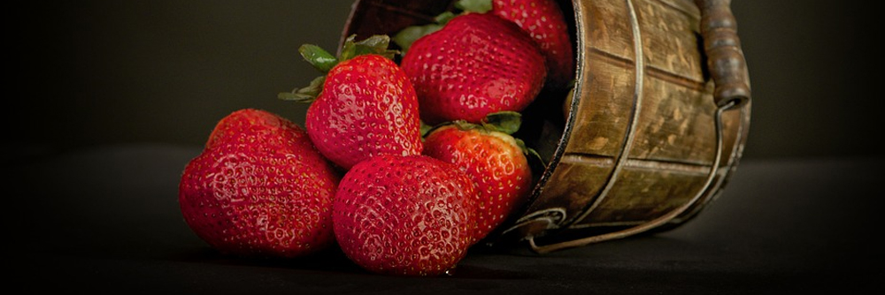 Strawberries falling out of a basket